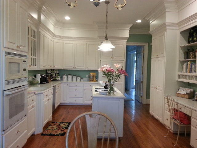 A view of their current kitchen. The doorway leads to the dining room.
