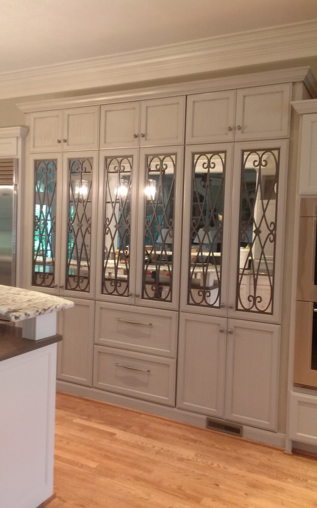 Back wall of cabinets. Ironwork and antiqued mirrors installed.